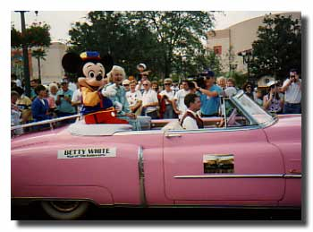Betty White riding with Mickey Mouse