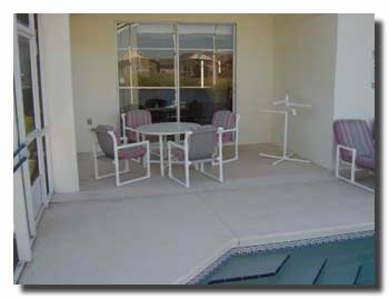 View of the lanai/patio with reflections of the lake