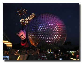 Epcot Leave a Legacy by night with Spaceship Earth behind