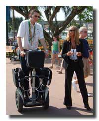 Disney Cast Member riding a Segway