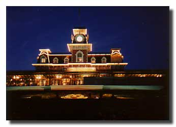 Disney's Main Street Railroad Station lit up at night