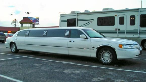 Travel around in style in a stretched limousine
