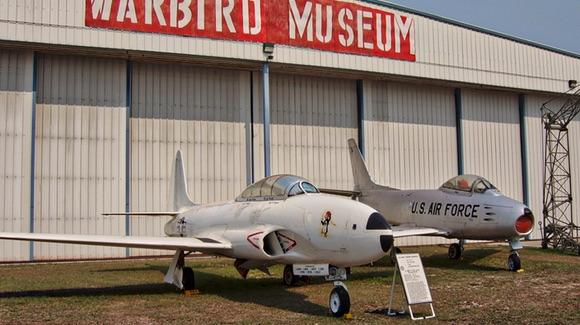 Lockheed T-33 Shooting Star and North American F-86F Sabre '52-5303' outside the Valiant Air Command Warbird Museum in Titusville